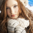 Teenage Girl Wearing Warm Winter Clothes And Hat In Studio - Foto Stock