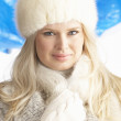 Young Woman Wearing Warm Winter Clothes And Fur Hat In Studio — Stock Photo