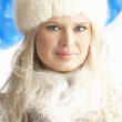 Royalty-Free Stock Photo: Young Woman Wearing Warm Winter Clothes And Fur Hat In Studio