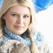 Stock Photo: Pretty Young Woman Wearing Warm Winter Clothes In Studio