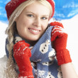 Young Woman Wearing Warm Winter Clothes And Hat In Studio - Foto Stock