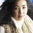 Young Woman Wearing Warm Winter Clothes In Studio - Stock Photo