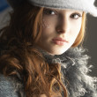 Fashionable Teenage Girl Wearing Cap And Knitwear In Studio - Stock Photo