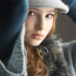 Fashionable Teenage Girl Wearing Cap And Knitwear In Studio - 图库照片