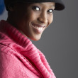 Fashionable Young Woman Wearing Cap And Knitwear In Studio - Stok fotoğraf
