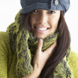 Fashionable Young WomanWearing Cap And Knitwear In Studio - Stok fotoğraf