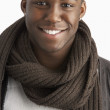 Young Man Wearing Warm Winter Clothing In Studio - Stock Photo