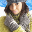 Young Woman Wearing Warm Winter Clothes And Hat In Studio - Stockfoto