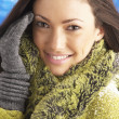 Young Woman Wearing Warm Winter Clothes In Studio - Foto Stock