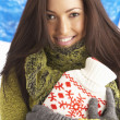Young Woman Wearing Warm Winter Clothes Holding Hot Water Bottle - Foto Stock
