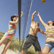 Stock Photo: Group Of Teenage Friends Playing Volleyball On Beach