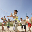 Group Of Teenage Friends Playing Volleyball On Beach — Foto Stock