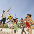 Group Of Teenage Friends Playing Volleyball On Beach — Stockfoto
