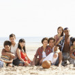 Royalty-Free Stock Photo: Group Of Friends Sitting On Beach Together