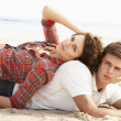 Romantic Young Couple Relaxing On Beach — Stock Photo