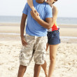Romantic Young Couple Standing On Beach — Stock Photo
