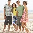 Royalty-Free Stock Photo: Group Of Teenage Friends Together On Beach