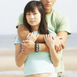 Romantic Young Couple Embracing On Beach — Foto Stock