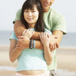Romantic Young Couple Embracing On Beach — Stock Photo