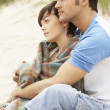 Romantic Young Couple Embracing On Beach - Foto Stock