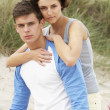 Stock Photo: Romantic Young Couple Embracing On Beach
