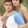 Romantic Young Couple Embracing On Beach — Stock Photo #4837975