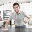Young Couple Cleaning Cleaning Modern Kitchen — Stock Photo #4838026