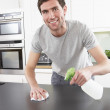 Young Man Cleaning Modern Kitchen — Stock Photo