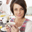 Royalty-Free Stock Photo: Young Couple Preparing Breakfast In Modern Kitchen