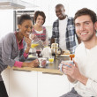 Group Of Young Friends Preparing Breakfast In Modern Kitchen — Stock Photo #4838047