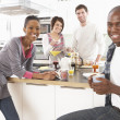 Group Of Young Friends Preparing Breakfast In Modern Kitchen — Stock Photo #4838051