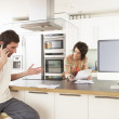 Young Couple Discussing Personal Finances In Modern Kitchen — Stock Photo #4838074