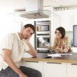 Young Couple Discussing Personal Finances In Modern Kitchen — Foto de Stock