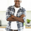 Young Man Cleaning Modern Kitchen - Stockfoto