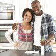 Young Couple Cleaning Cleaning Modern Kitchen - Stockfoto