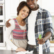 Young Couple Cleaning Cleaning Modern Kitchen - Stock fotografie