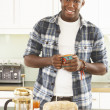 Young Man Preparing Breakfast In Modern Kitchen — Stock Photo