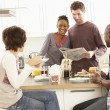 Group Of Young Friends Preparing Breakfast In Modern Kitchen — Stock Photo