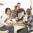 Group Of Young Friends Preparing Breakfast In Modern Kitchen — Stock Photo #4838119