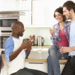 Group Of Young Friends Enjoying Glass Of Wine In Modern Kitchen — Foto de Stock