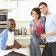 Group Of Young Friends Enjoying Glass Of Wine In Modern Kitchen — Stock Photo