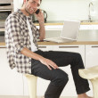 Young Man Relaxing Sitting In Kitchen Talking On Phone — Stock Photo
