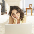 Woman Using Laptop Relaxing Laying On Rug At Home — Stock Photo
