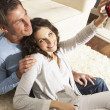 Couple Taking Photograph On Digital Camera At Home - Stockfoto