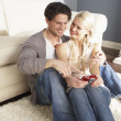 Stock Photo: Couple Taking Photograph On Digital CamerAt Home