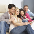 Group Of  Friends Looking At Pictures On Digital Camera At Home — Stock Photo