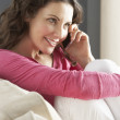 Woman Relaxing Sitting On Sofa At Home Talking On Phone — Stock Photo
