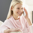 Woman Relaxing Sitting On Sofa At Home Talking On Phone - Foto de Stock  