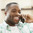 Young Man Relaxing Sitting On Sofa At Home Talking On Phone — Stock Photo