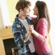 Romantic Young Couple Dancing Together In Living Room — Stock Photo